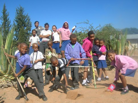 Some of the kids from the primary school, eager to pose with the gardening tools