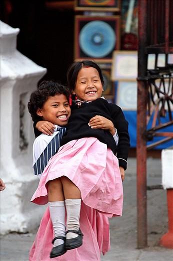 Nepaliese kids playing outside a school in Khatmandu