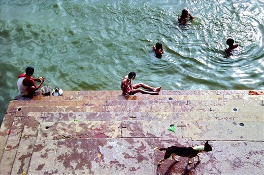 The Ganges River is heavily polluted at Varanasi, priests and rituals are everywhere and bodies are cremated in public. At sunset, pilgrims and locals alike bathe in the Ganges as part of their daily hindu rituals.