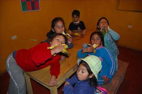 Children eating bananas at 'Seeds of Hope'