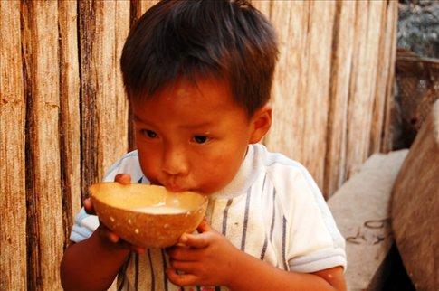 Rickson drinking chicha- Juyuintza tribe- Ecuadorian Amazon