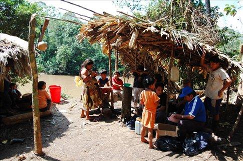 Doctor Carl giving out medicines to the Shiwiar tribes- Ecuadorian Amazon
