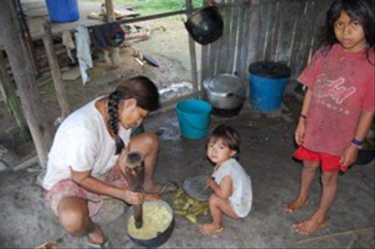 Señora Rosa preparing breakfast- Juyuintza tribe- Ecuadorian Amazon