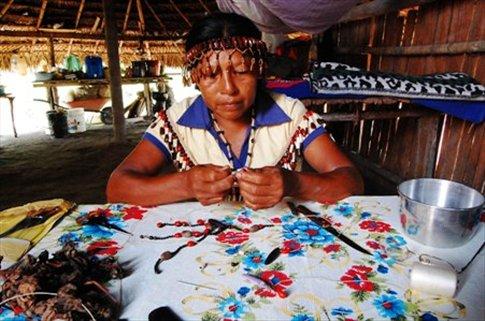 Fanni making necklaces- Juyuintza tribal village- Ecuadorian Amazon