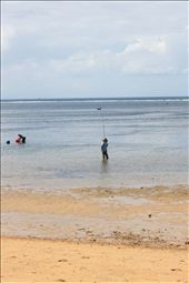 A fisherman - fishing just few metres from a five star resort: by sissi, Views[93]