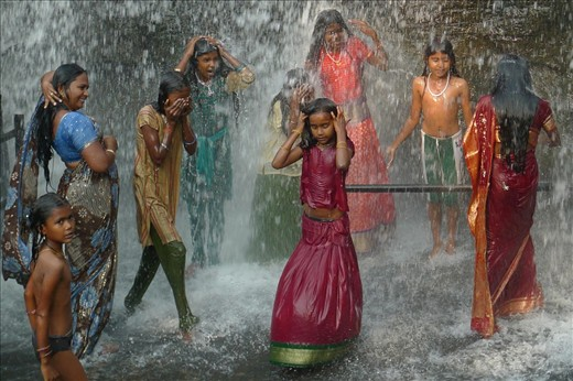 Women and girls bathe in a gender-segregated waterfall ...