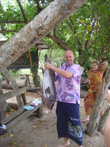 Me in Bula shirt with a huge grouper caught for dinner by Marau!