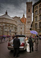 About 30 seconds after walking past the Florence Duomo, the rain started.  I ran back and was photographing the explosion of colours (umbrellas) reflected in the wet surface when this Bride turned up. It amazes me that while tourists  flock to Italy's beautiful architecture, Italians  go about their business as if these wonders are an everyday thing. To them, of course, they are.: by smarlin, Views[313]