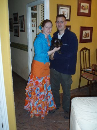 Shannon and Rob (and Little Bear) before going to Feria.  Shannon is wearing a traditional Spanish Flamenco dress.