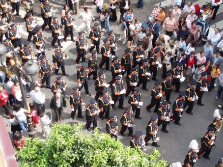 A band processing with the paso through the streets