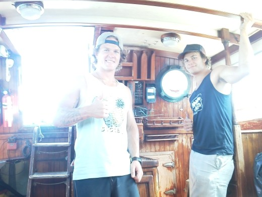 Kevin & Tyler inside their round the world sailboat.