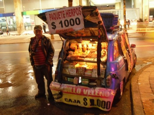 a man selling a trunkful of sweets out of the back of his car
