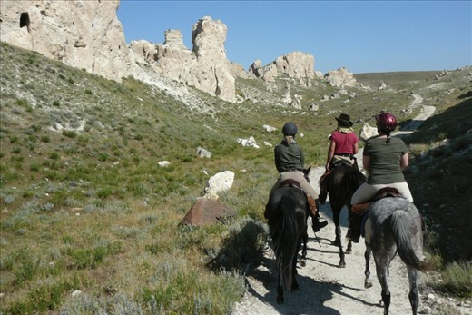 ON HORSEBACK – Bringing dental relief to rural towns in the hoodoo landscape of Cappadocia, Turkey. Relief Riders International organises horseback journeys to provide humanitarian aid to remote areas. On their way to the next village, the riders are flanked by tall stone outcrops atop steep hills of scrub-grass in a spectacular narrow valley straight from a John Ford western.