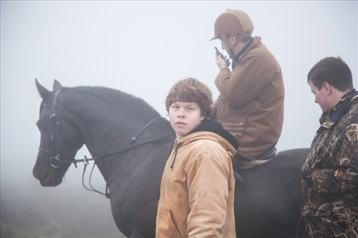 David Wallace and his son search through the fog for their herd. They comb the 10 square mile stretch on horseback, quadbike and on foot until they find and can push the wild ponies towards their farm.