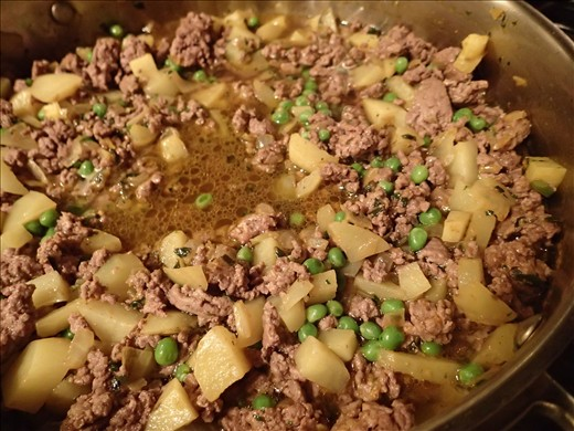 Filling mixture simmering with beef broth added