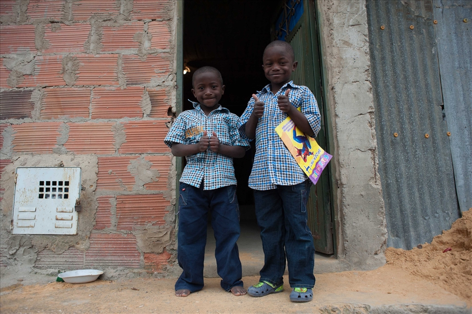 Both represent  many children displaced by war. They`re happy celebrating xmas.