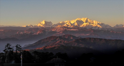 The Himalayas has been known for its vast ranges, highest peaks and the roughest weathers with the coldest breeze but above it is the beauty of this mountain that keeps it segregated from the rest. The setting sun turns the mountain into gold. Sandakhphu West Bengal, India