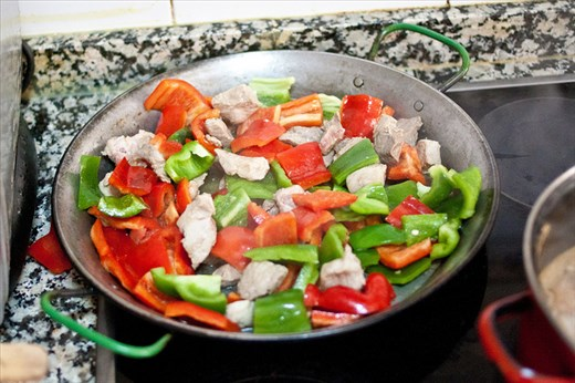 Sauteing Peppers and Rabbit