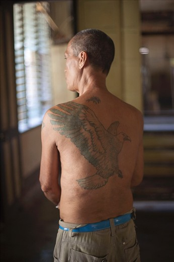 This man displays his tattoo , a reminder of what his life was before he got leprosy and before he become a part of this community in Culion. He says,
