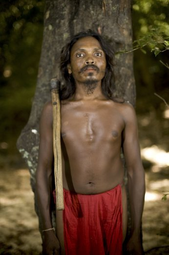 This man of the Dambanna Vedda Tribe evoked many feelings of the pride tribal warrior of days past.  His intense eyes and uncompromising seriousness increased the feelings of being deep in the jungle.