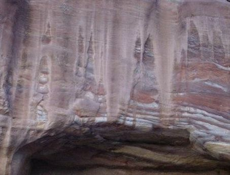 Rosy dripping rock formations all over Petra.