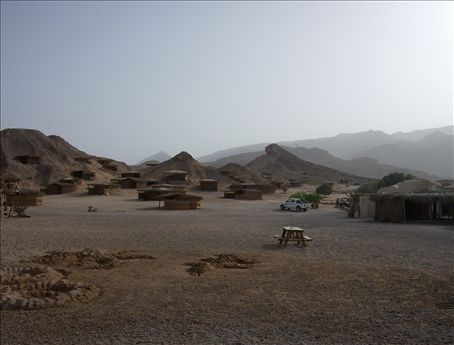Back to the land. Simple little huts on the beach at Ra's-a-Shaytan (Devil's Head)