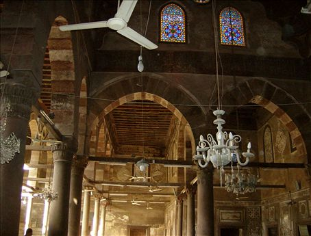 Merdani Mosque's 1200 year old rafters, and somewhat newer ceiling fans.