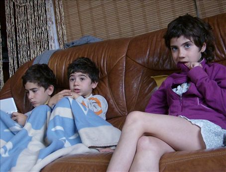 Three kids and Saturday morning cartoons. Pol, Didac, and Melissa.