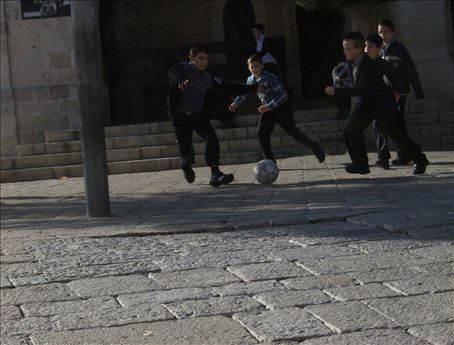 Little Jews play soccer, part deux. Its funny watching them run while keeping their yarmulkes on, their baby payas swishing in the wind.