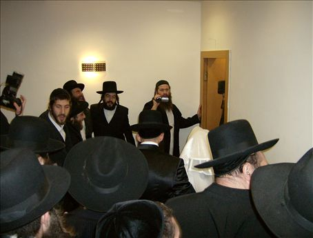 The chasan and kalah about to step into the cheder ha-something, to be together, alone, for the first time in days.