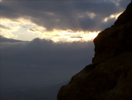 Ashreinu. The sun peaks out of the clouds and its shaft of light moves across the crater floor.