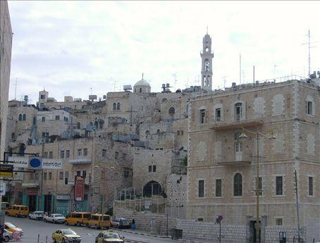 The minaret of the Mosque of Omar rises above the Bethlehem 'skyline'.