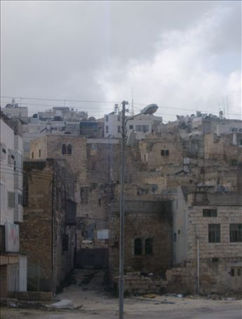 A bleak day, but still, it fits. The mighty, Hebron. Note that it is in this city that the recent Israeli army activities in Gaza have provoked the most violent response.
