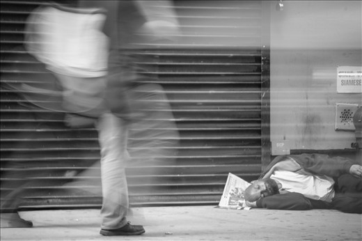 Sitting and catching my breath out side a shop that my wife loves I was watching this homeless man sleeping on the street. I noticed the people constantly walk past him and never once acknowledging him there. It made me sad but grateful for what I have. I took this photo to show how cold and naive people can be. (I was happy to give him some money and a bottle of water, he was thankful)