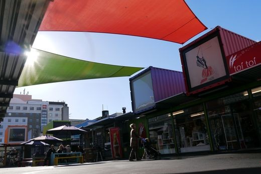 """It's hard to imagine how life can go on in a city that was hit so heavily, but Christchurch fights back – the """"Re:Start"""" project in the """"Red Zone"""" and former downtown area gives shop owners the possibility to reopen their businesses – rebuilding the center will take at least another 10 to 20 years. New hope for Christchurch."""