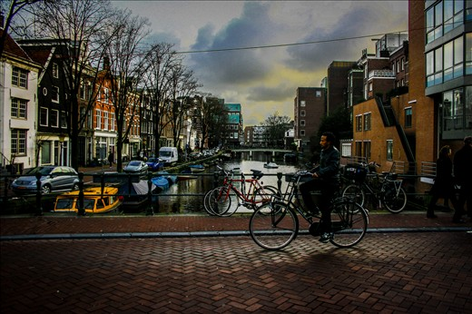 The photo shows the usual daily life in Amsterdam, Netherlands.