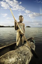 A young Malawian girl posing in a dugout canoe used for fishing.: by stefaniegiglio, Views[456]