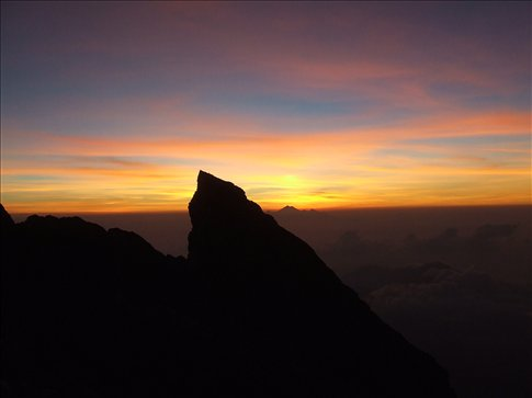 The sunrise fom the top of Agung, Gunung Rinjani on Lombok is in the distance.