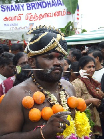 A lot of Thaipusam devotees pierce themselves - ouch!