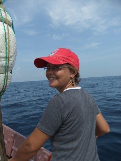 A very happy Emma after spotting Spinner dolphins and Sperm whales.