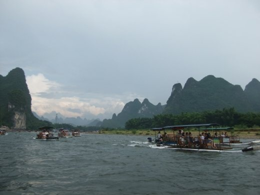 Some of the many 'bamboo' plastic rafts on the river.