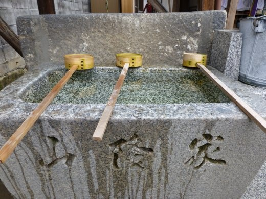 Didn't quite get to grips with the water rituals before entering a temple.