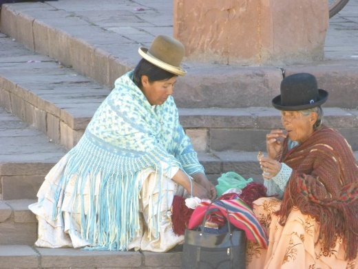 People like to sit around and relax in the main squares, this is in Tiwanaku village.