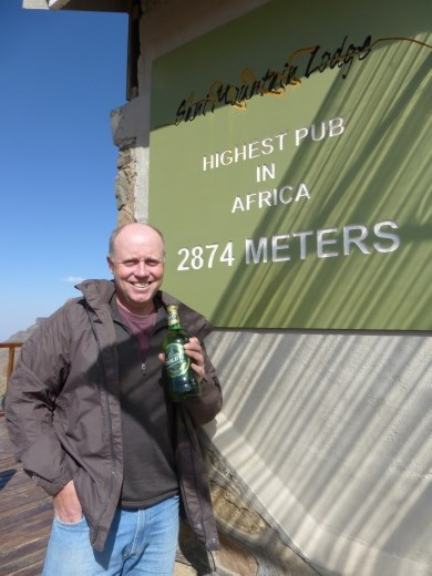 Having a Lesotho beer at the highest pub in Africa.