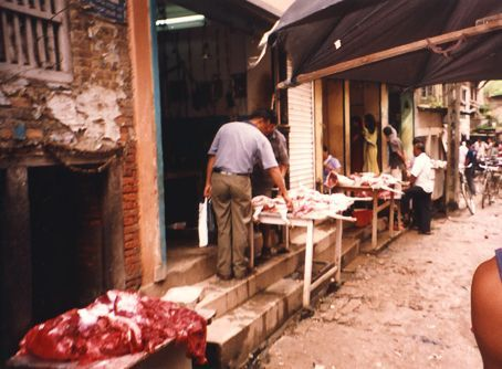Open air butchers in Kathmandu. The tables with the meat on them are directly above the street gutters and the blood from the meat runs off to join with the sewerage. It kinda smelt a bit...