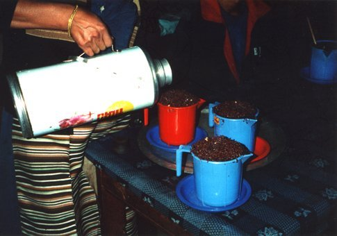 Being served 'Tomba' in a very dark & seedy bar in Lukla, Nepal. I think it's fermented millet seed & boiling water. Gets you quite drunk, especially by the jugfull...