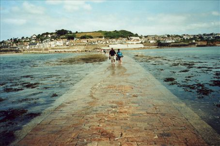 Tidal causeway leading from St Michaels Mount back to the mainland, with the tide coming in, shortly before my feet get very wet.