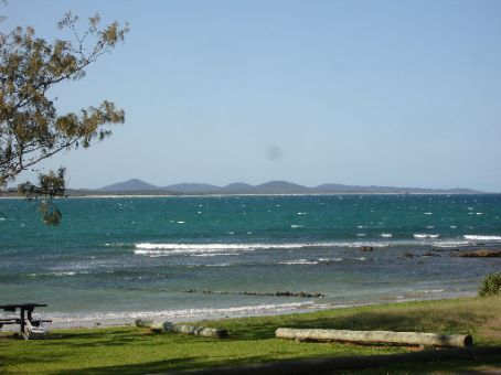Old Aboriginal fish-trap at Arrawarra headland at high tide