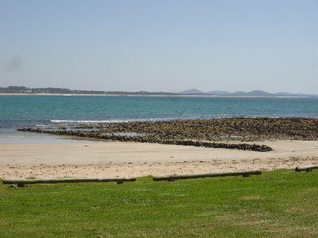 Old Aboriginal fish-trap at Arrawarra headland at low tide