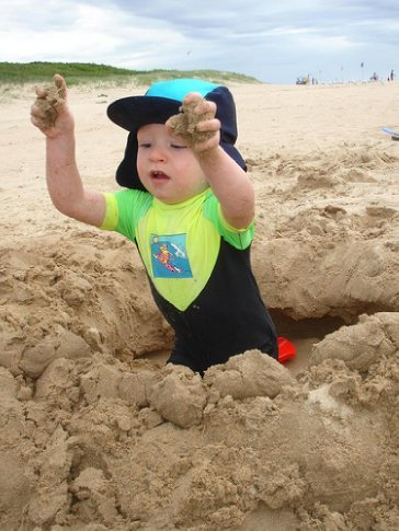 New Years Day on the beach at Wollongong: Charlie practicing his excavation skills